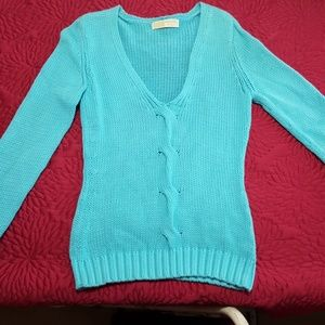 Turquoise Michael Kors sweater.